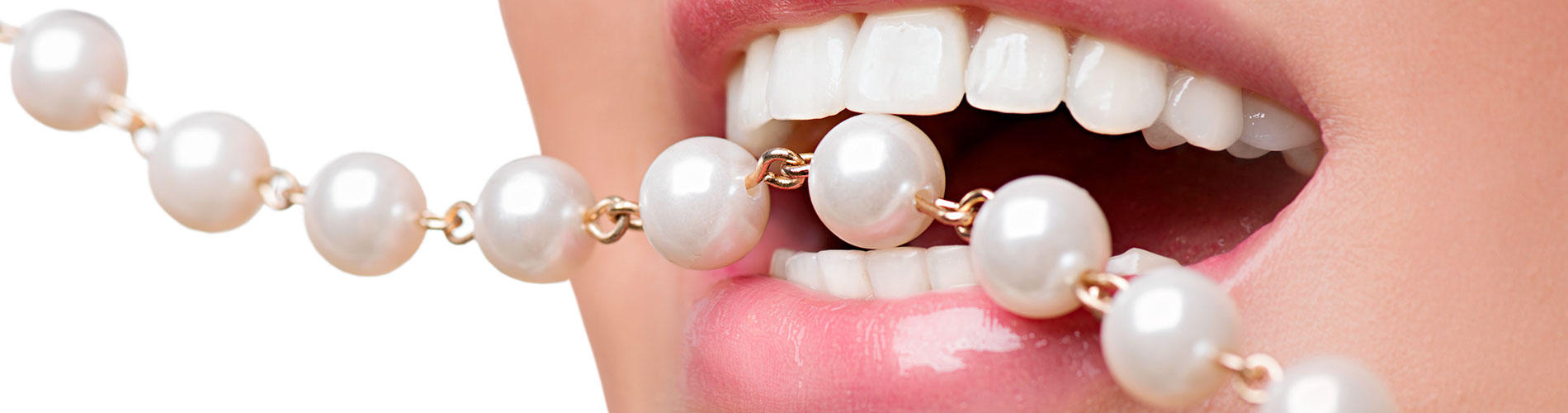 Woman biting on a pearl neckless